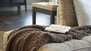 home-life-couch-blanket-glasses-book